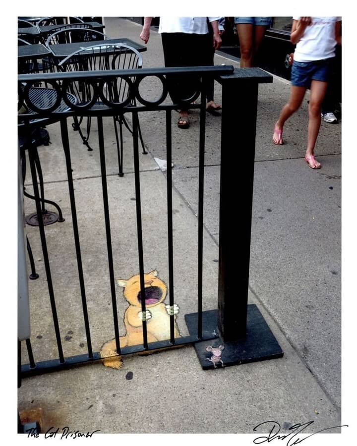 02-The-ginger-cat-in-jail-www-designstack-co