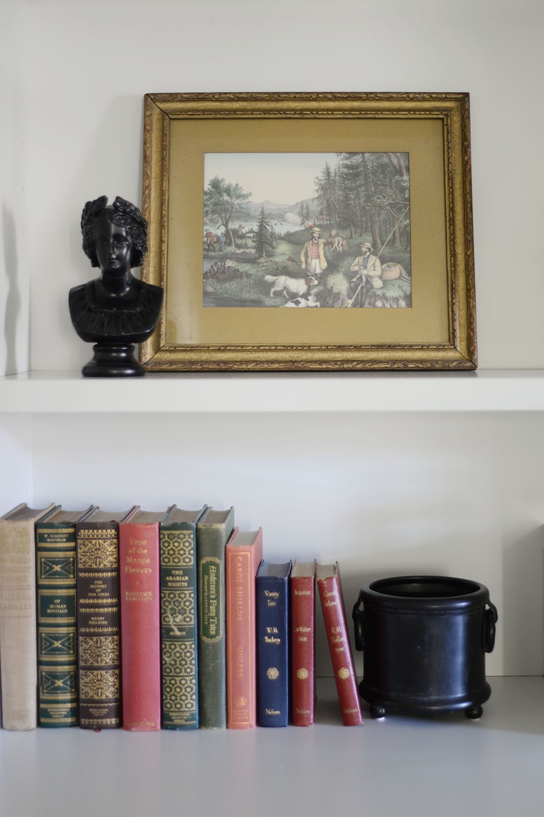 vintage hunting print, vintage books, bookcase styling, miniature bust, fall decor ideas, fall living room