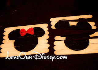 Great toddler activity to get excited for Disney. DIY Disney popscicle stick puzzles. LoveOurDisney.com