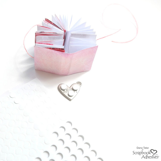 How to Attach a Silver Metal Heart Embellishment to a Mini Book Cover with Small 3D Foam Circles
