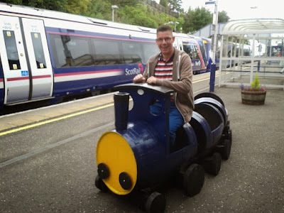 Riding a little train at Falkirk High railway station in 2014