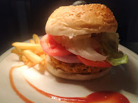 Serving veg burger with french fries and sauce for veg burger recipe
