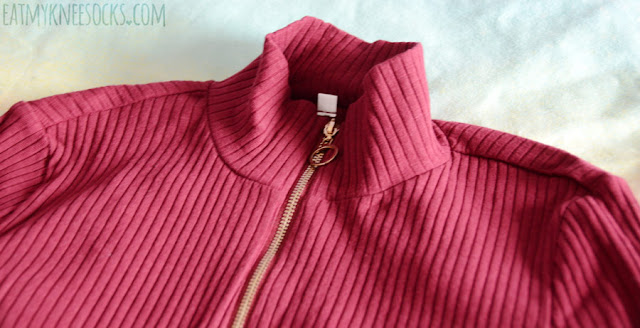 Details on the wine red/burgundy ribbed long-sleeve mock neck top from SheIn, a style similar to the UNIF Noob bodysuit.
