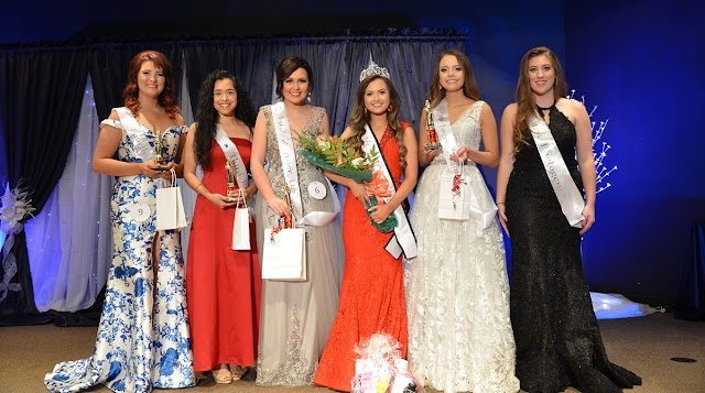 a group of women in gowns and sashes