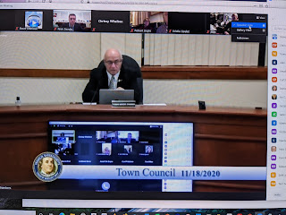 Town Council chair Tom Mercer opens the meeting