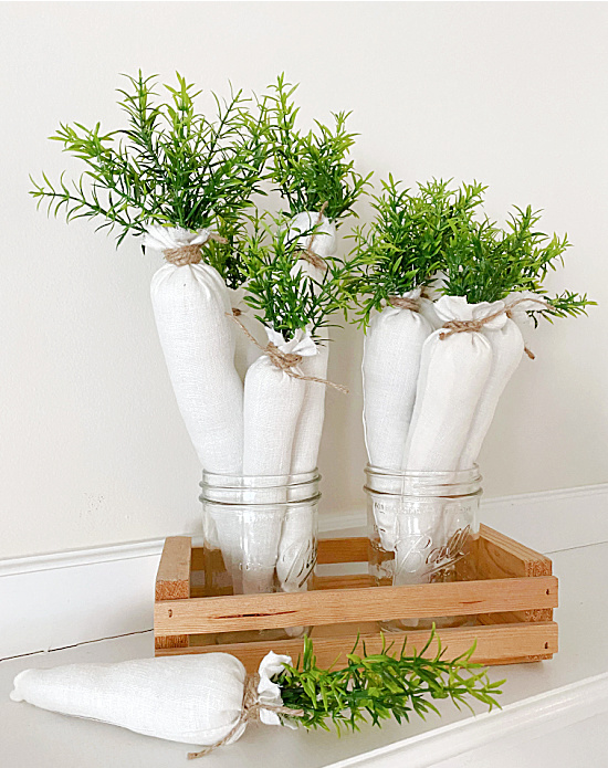 crate of Mason jars and white carrots