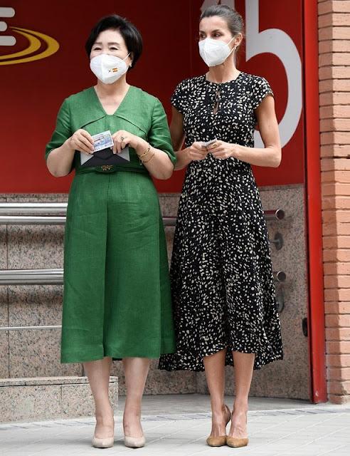 Queen Letizia wore an animal print dress from Massimo Dutti. Carolina Herrera suede slingback pumps and astrud clutch