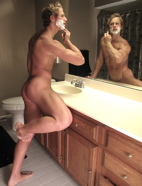 Man shaving naked