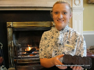 peat brick held by Ciara Ryan at The Merrion Hotel in Dublin, Ireland