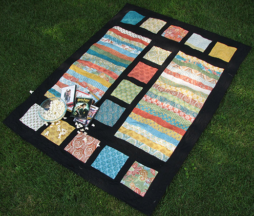 Film Strip Quilt Free Tutorial designed by Cara Wilson of CaraQuilts for Modabakeshop