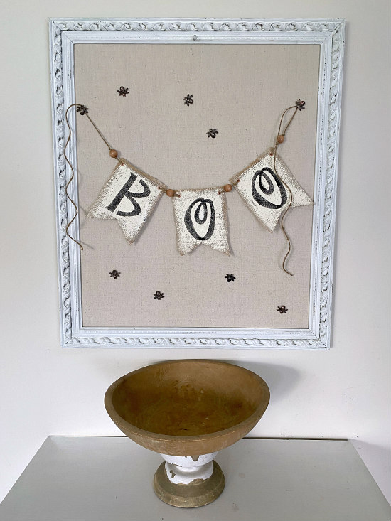 Wooden bowl and framed bulletin board with boo banner