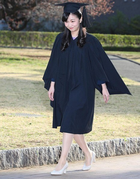 The younger daughter of Prince and Princess Akishino wore a black gown and mortarboard for the graduation ceremony