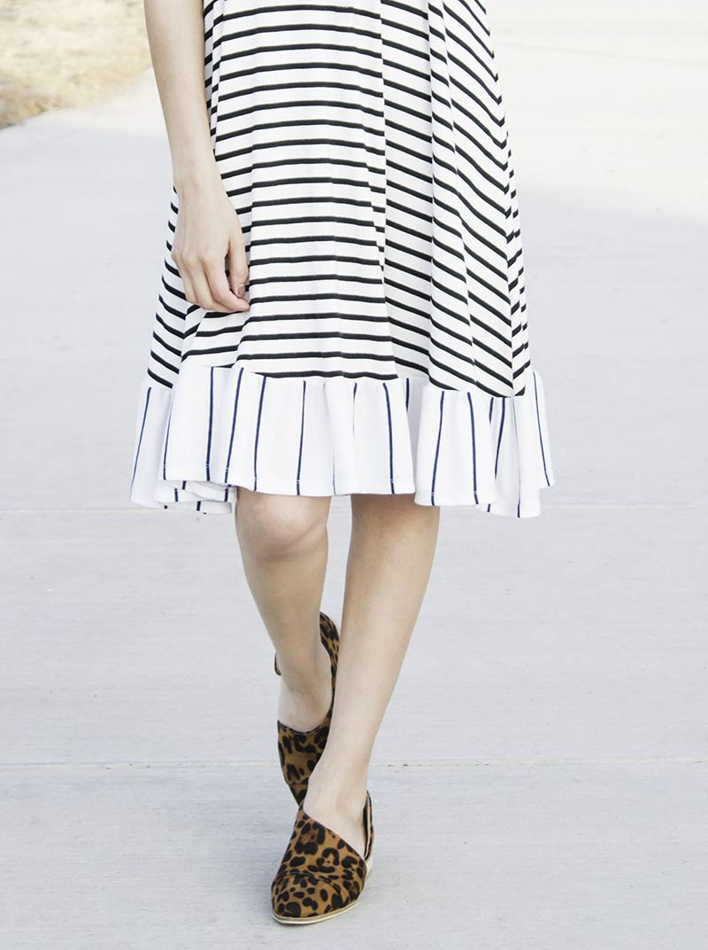 striped ruffle dress with leopard booties close up