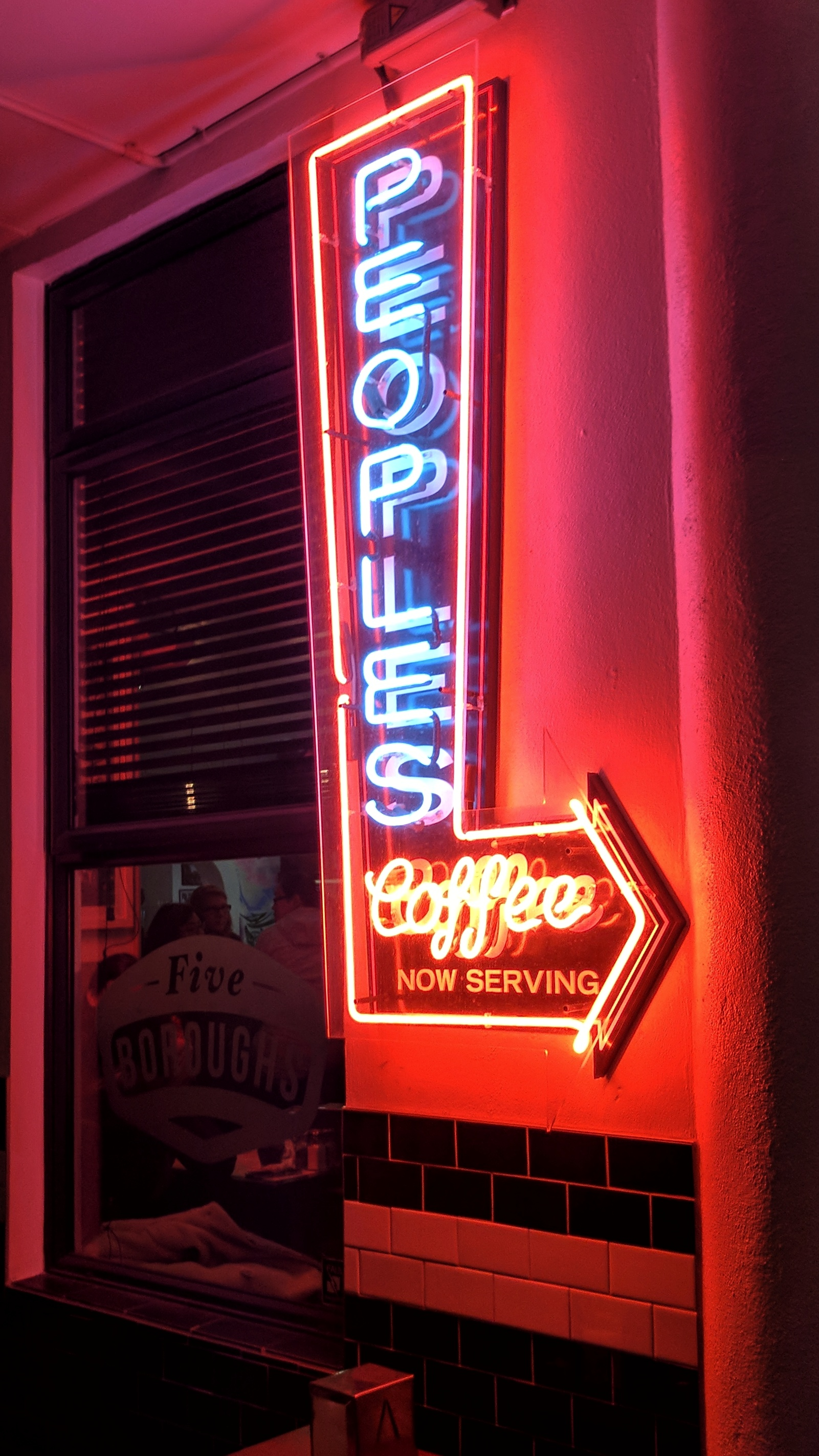 'Peoples Coffee now serving' neon sign