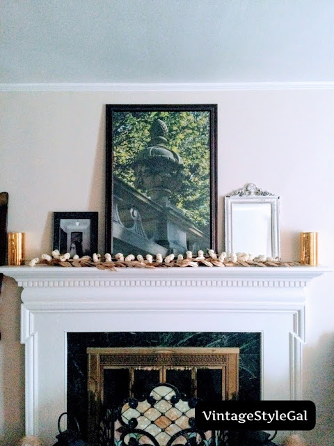 Add in gold hurricane globes on either end of mantel