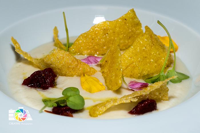 Crema di topinamburr, pomodorini ciliegini confit , chips di polenta