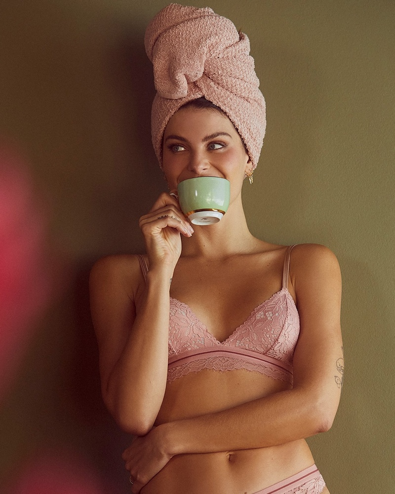 Posing with a tea cup, Isabeli Fontana fronts Love Stories x Riachuelo campaign.