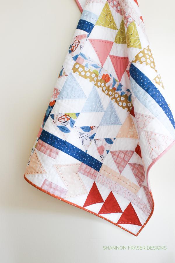 Rollakan Flight Plan Quilt | Modern Quilt Pattern | Shannon Fraser Designs #modernbabyquilt #babyquilt #handquilted
