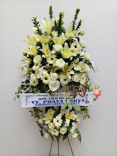 standing flower deepest condolences