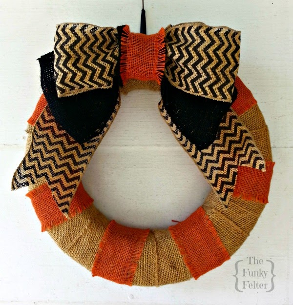 orange and black striped wreath with chevron patterned bow for Halloween