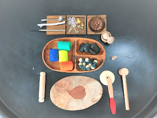 playdough with natural resources and wooden tray