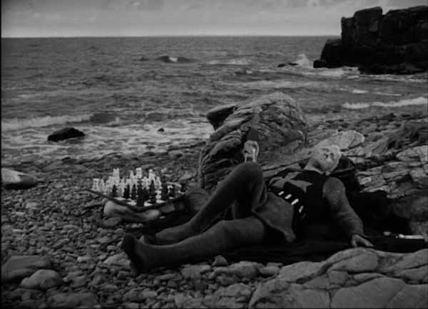 Max von Sydow as a knight lying on a beach