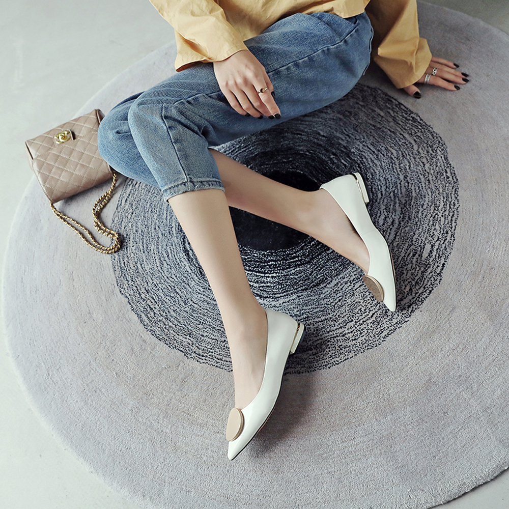 a photo of legs wearing almond pumps