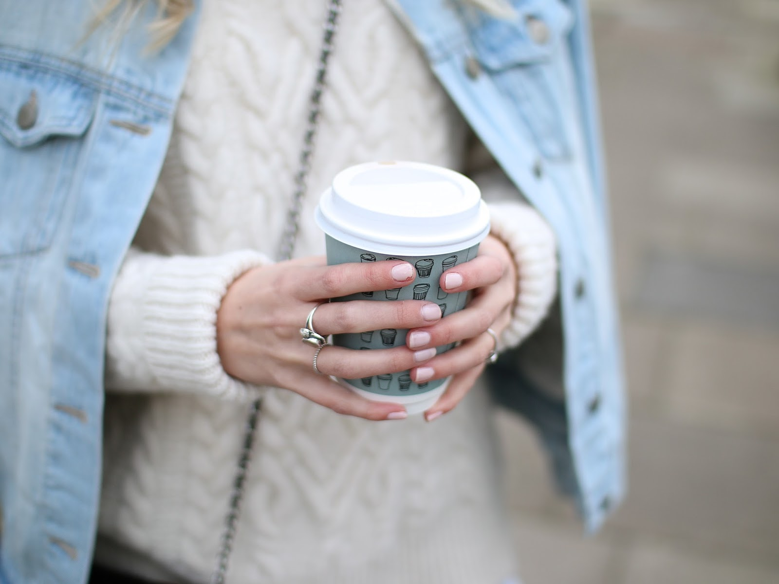 a women holding a waitrose coffee cup with light pink nail polish by barry M