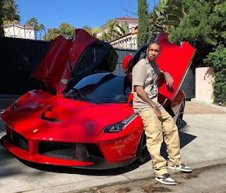 Picture of Pasionaye Nguyen's son Tyga with a car