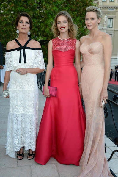 Princess Caroline wore a white lace and black trimmed Chanel Spring 2013 Couture gown Princess Charlene wearing Versace Gown