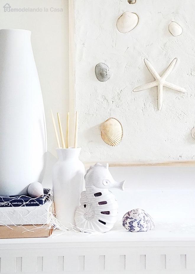 white vases, seahorse, shells, fish net