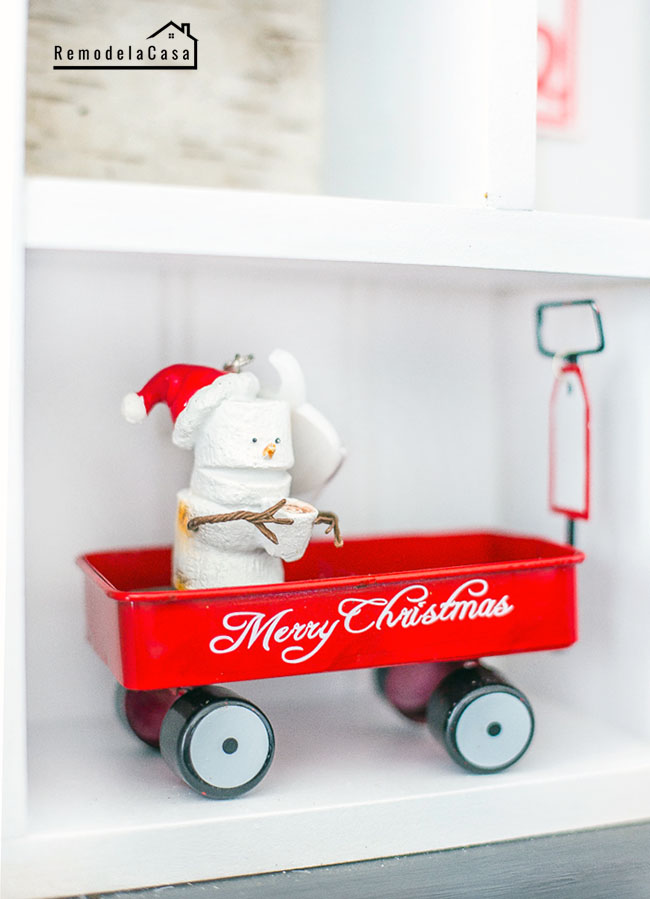 Marshmallow snow man inside little red wagon