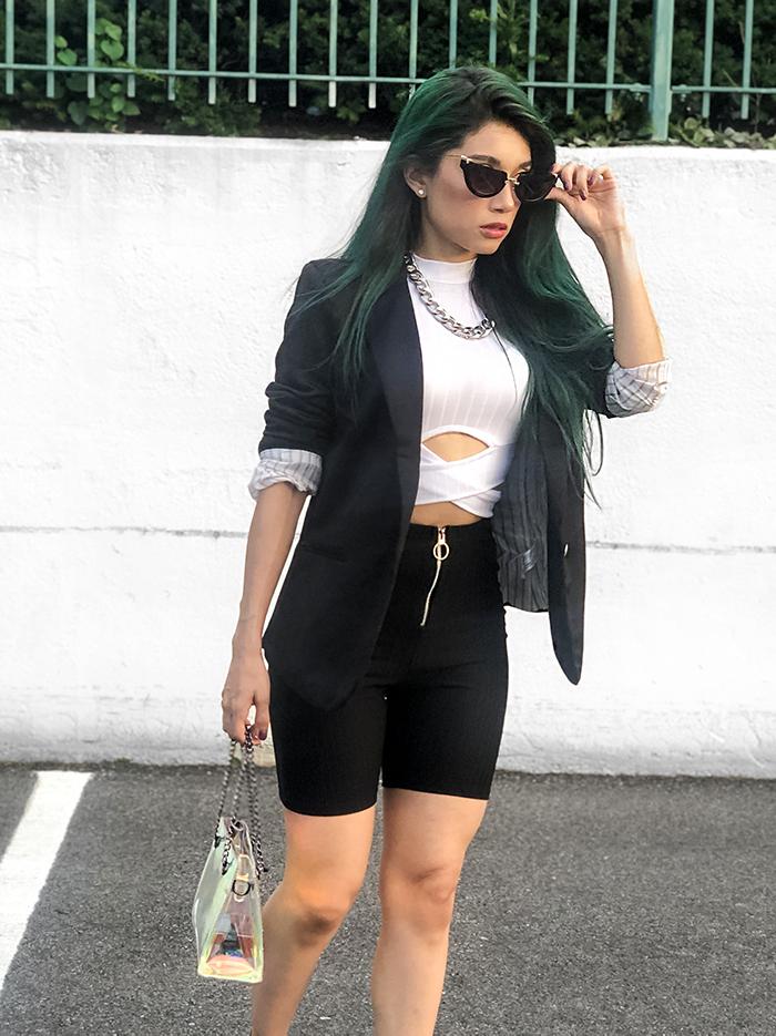 close up green hair sunglasses biker shorts balck black blazer white top silver accessories