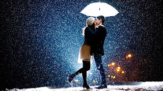 boy-and-girl-Lovers-kiss-in-snowfall-flakes-image.jpg