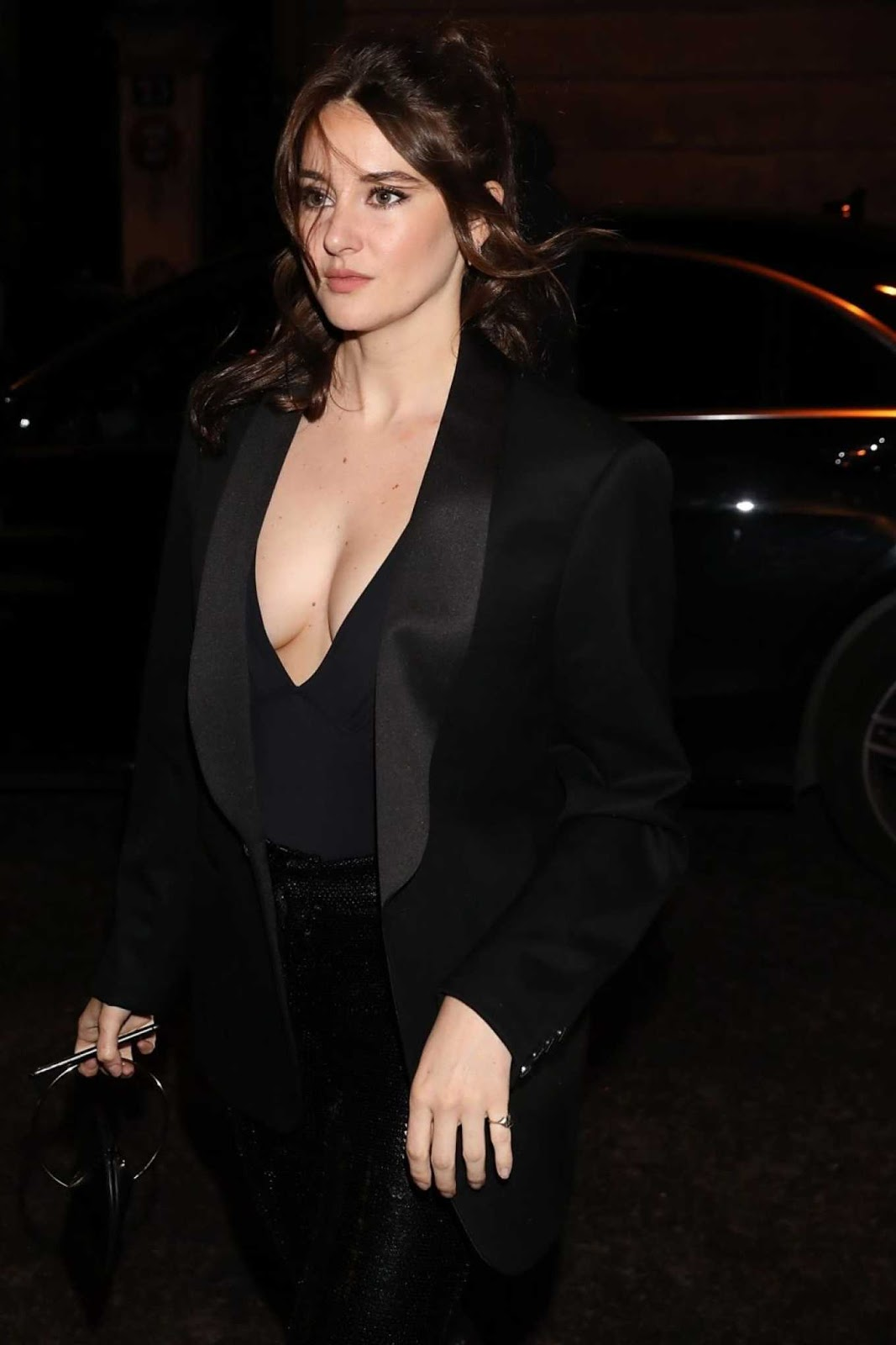 Shailene Woodley puts ample cleavage on show at the Monot Fashion Show in Paris