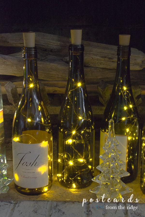 wine bottle lights inside a fireplace