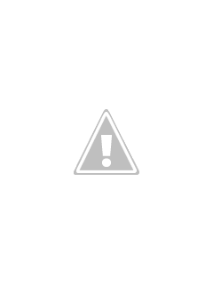 Child measuring stacked candy corn for a fun Halloween STEM activity