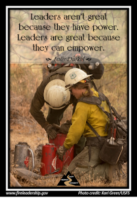 Leaders aren't great because they have power. Leaders are great because they can empower. - Lolly Daskal (Crew members filling drip torches together.)