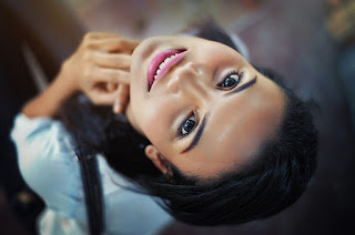 smiling-woman-looking-upside-down.jpeg