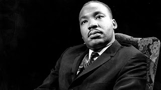 Photo portrait of Martin Luther King Jr in black and white