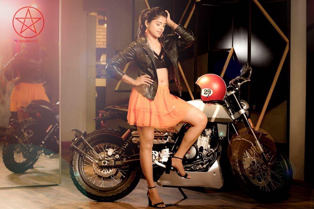 Sanchita Shetty hot stills as biker girl