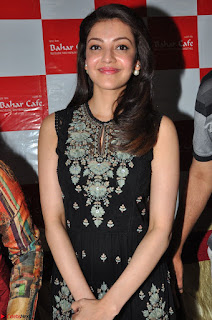 Kajal Aggarwal in lovely Black Sleeveless Anarlaki Dress in Hyderabad at Launch of Bahar Cafe at Madinaguda 041.JPG