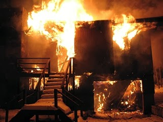Picture of a house on fire.