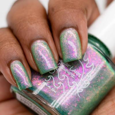 green nail polish with pink to green shifting flakes and shifting shimmer on dark skin