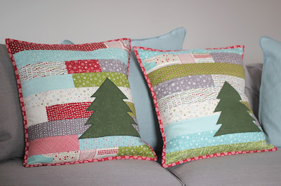 Christmas quilted pillow using Jelly Rolls and appliques