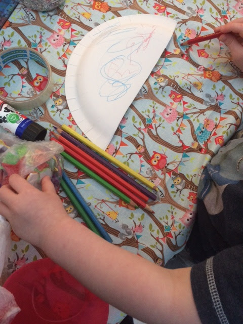Child decorating paper plate