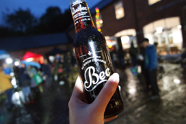 Female hand holding up a bottle of Bec cola