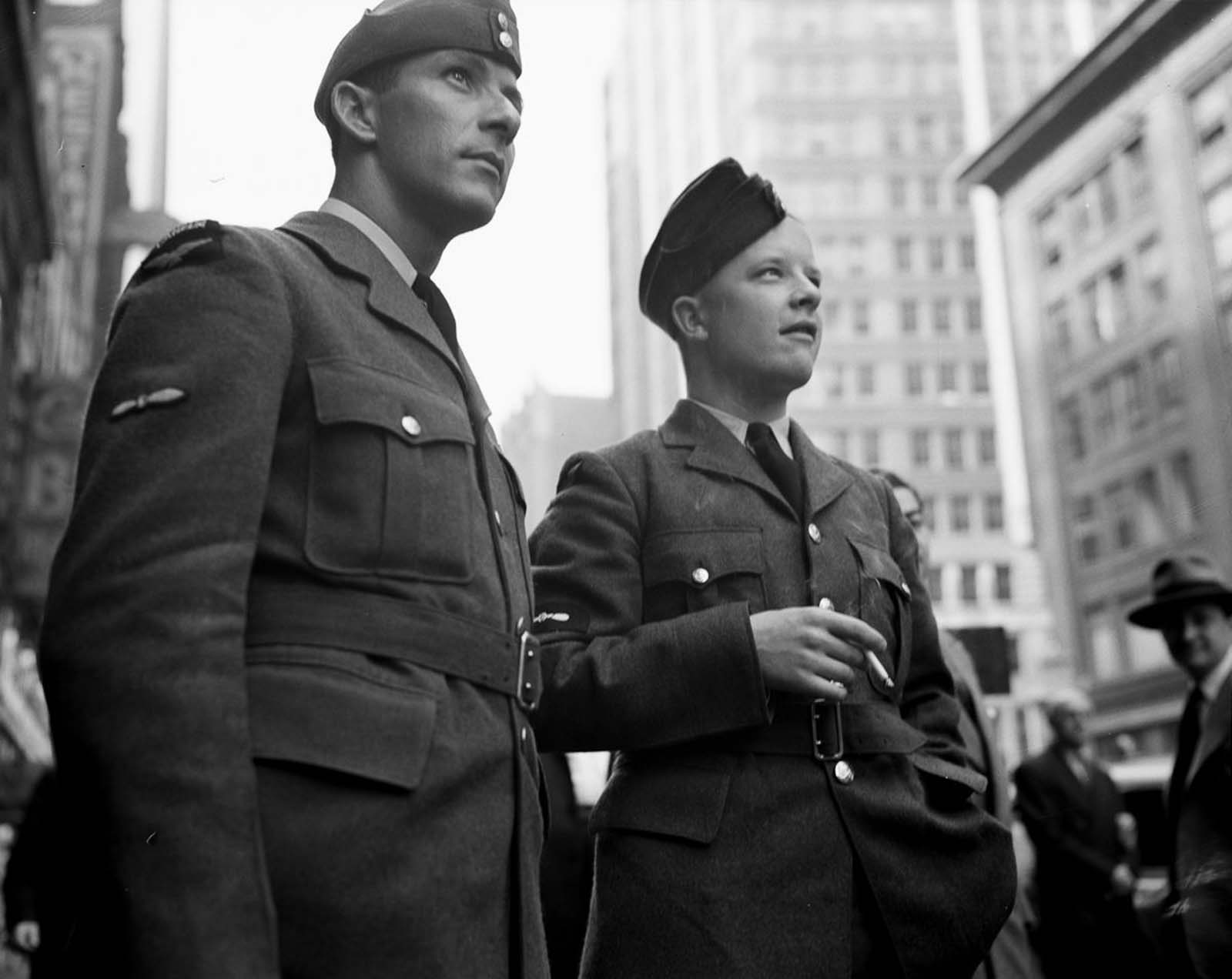 Two soldiers join the crowds as they expectantly wait for more updates.
