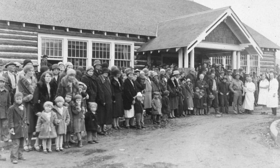 Residents of Darby line up at a schoolhouse to get free vaccinations against Rocky Mountain spotted fever in the 1930s.