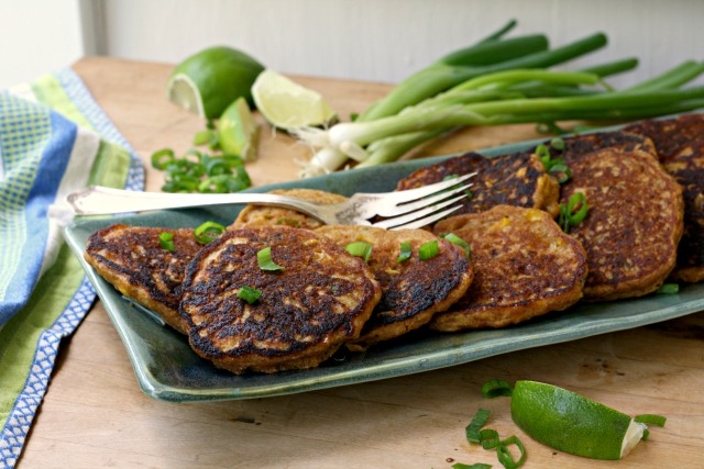 Lightly spiced and filled with herbs, molasses corn fritters suit breakfast and supper.